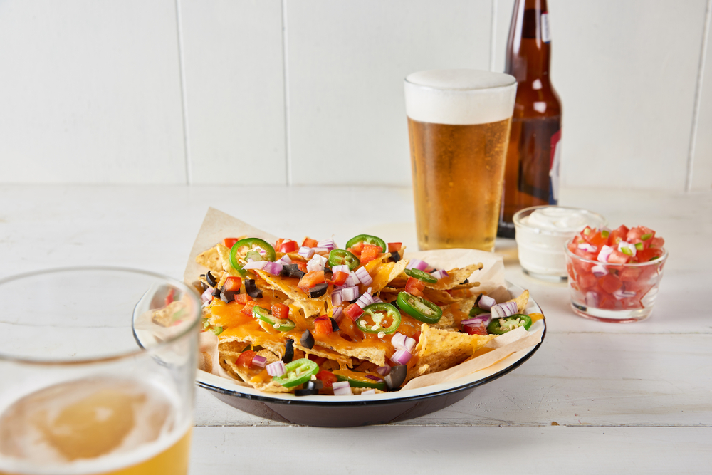 Nachos and Beer in a Restaurant Setting