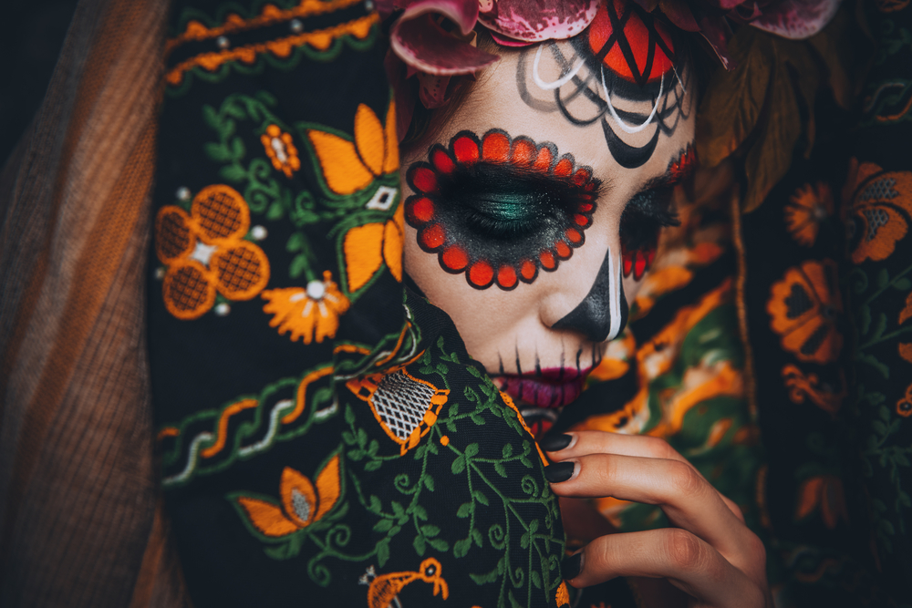 Young woman with sugar skull makeup